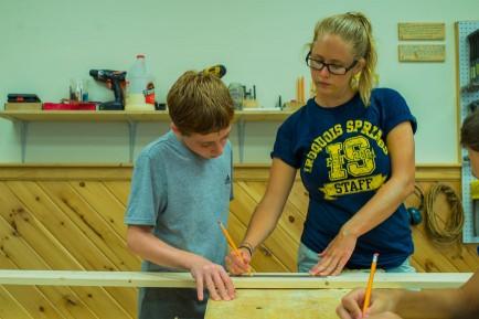 boy-instructor-wood-shop